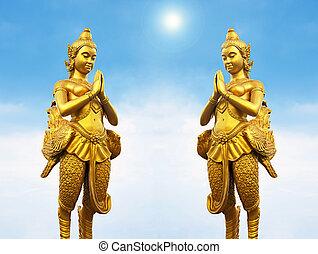 Golden Thai style statues acting Wai or Sawasdee - Golden...