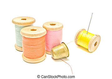 golden thimble and four spools of thread