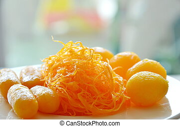 golden threads and bean paste with egg yolk fudge balls cooked in syrup assorted Thai sweetmeat on dish