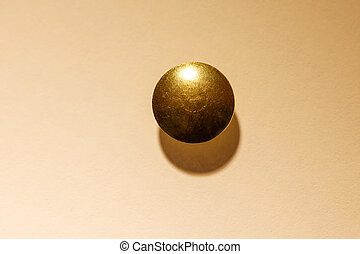 golden thumb tack thumb tack push pin with a white background