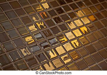 Golden tiling - Some glossy, golden colored bathroom tiling...