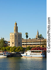 cityscape of Sevilla with Golden Tower (Torre del Oro), Andalusia, Spain