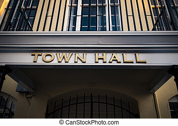 Golden town hall sign at local government office