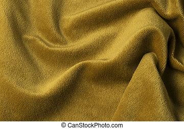 Golden velour fabric background, velvet, mohair, cashmere effect.