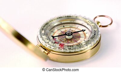 Golden vintage compass circling, arrow moves during that...
