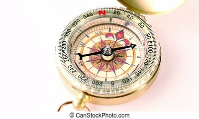 Golden vintage compass rotates, arrow moves during that...