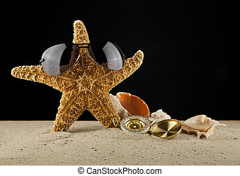 Golden vintage compass, shells and starfish on sand