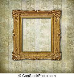 Golden vintage empty frame on a floral stylized background