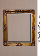 golden vintage frame on wall