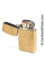 Golden vintage lighter isolated on white