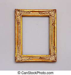 Golden vintage picture frame on a wall.