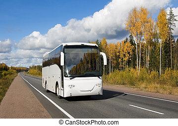 golden voyage - tourist bus, autumn, highway Scandinavia