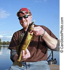 golden walleye on a lake