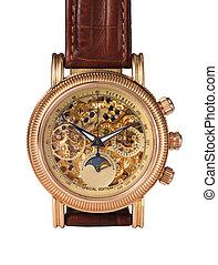 Golden watch mechanism, macro detail.
