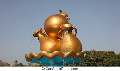 Golden water jug in Muscat - Golden water jug at a...
