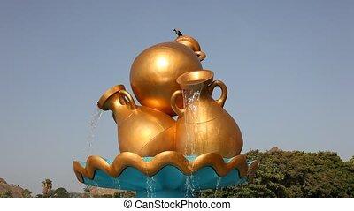 Golden water jug in Muscat - Golden water jug at a...