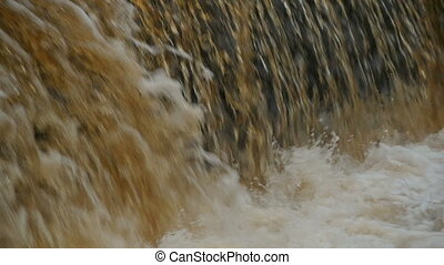 Golden waterfall close to, slow motion