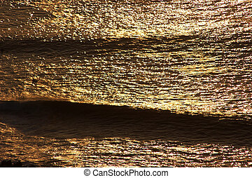 Golden waves at sunset