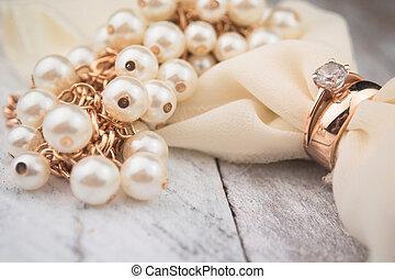 Golden wedding rings on white wood