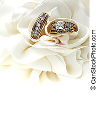 Golden Wedding Rings - His and her gold wedding bands,...