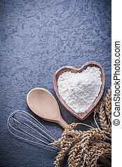 Golden wheat rye ears wooden spoon bowl flour egg whisk.