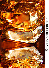 Golden Whiskey - Backlit whiskey in glass tumbler with...