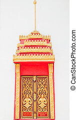Golden Wood Carving ,Traditional Thai Style at the window of church in Thai Temple.