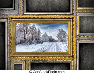 golden wooden frame with beautiful landscape among other ...