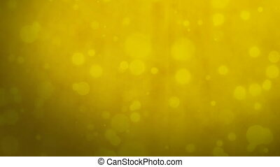 Golden yellow background with floating particles