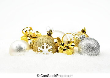 Golden,silver christmas decoration on snow