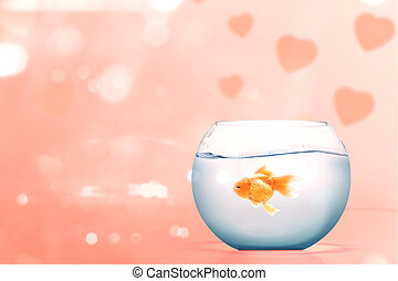 Goldfish in the fishbowl on a pink background