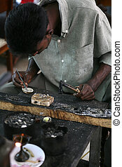 Goldsmith at work - A Sri Lankan goldsmith smelting...