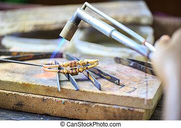 Goldsmith making bracelet - Goldsmith working with a thai ...