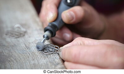 Goldsmith Polishing Silver Earring with Grinder