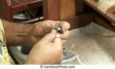 Goldsmith working on rings