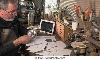 goldsmith working with silver - creative drawing of a silver...