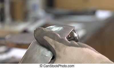 goldsmith working with silver