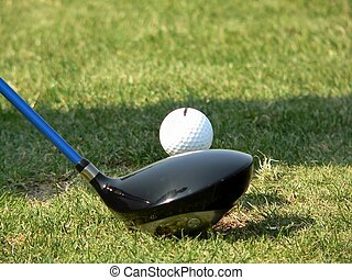 Golf - a closeup of the driver and ball