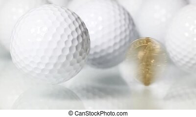 Golf and money - Rotating U.S.dollar and white golf balls