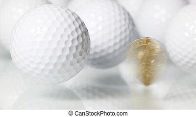 Golf and money - Rotating U.S.dollar and white golf balls