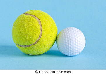 golf and tennis balls on azure background - golf and tennis...