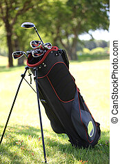 Golf bag replete with clubs