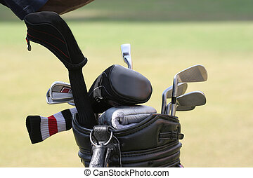 Golf bag with set of clubs