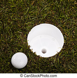 Golf ball and cup