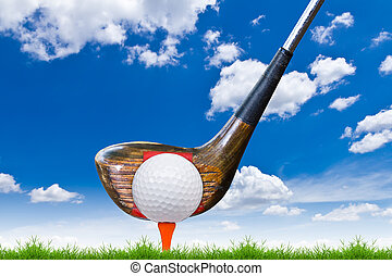 golf ball and driver on green grass