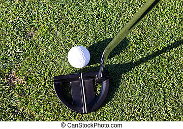 Golf ball and putter club