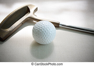 golf ball and putter on white background