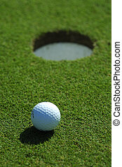 Golf ball close to the hole