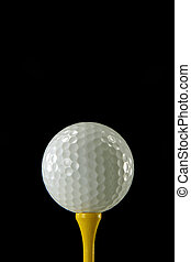 Golf Ball Closeup - Closeup of a White Golf Ball on a Yellow...