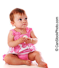 Golf-Ball Concerns - An adorable baby girl quizically...